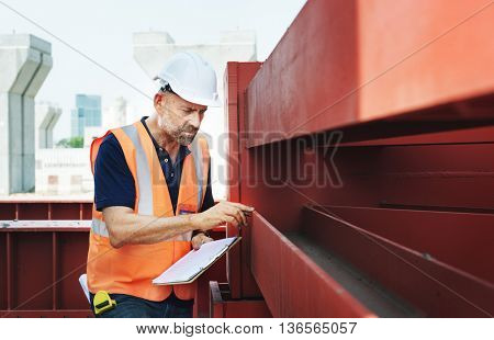 Construction Site Engineer Working Blueprint
