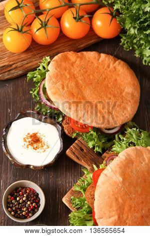 Freshly Baked Pita Bread On A Wooden Table Close-up.
