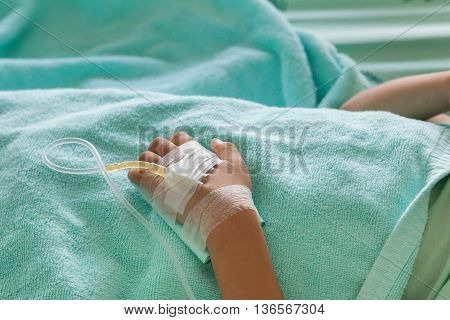 Little Boy Sick In The Hospital With Saline Intravenous (iv),focus Hand