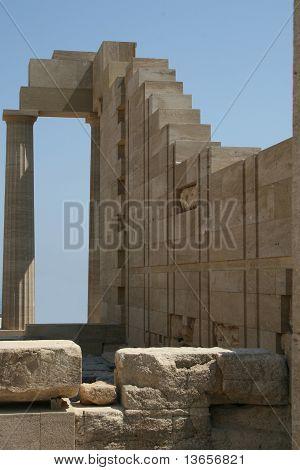 rebuilding column in Akropolis Lindos Greece