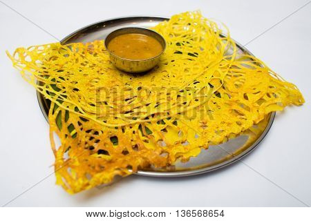 Indian tray meal with yellow bread and sauce