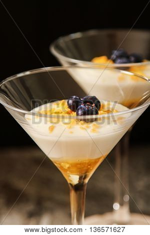 White Yogurt With Gold Honey In A Glass.