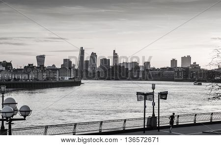 London, UK - May 21, 2015: City of London view at dusk. Modern business and banking aria with first night lights and River Thames