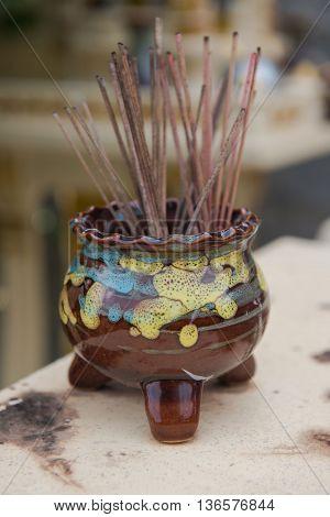 Incense burner Brown on a table. Background