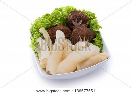Fresh sea cucumber with mushroom and salad in white bowl