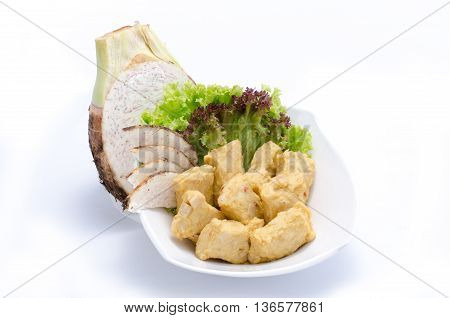 Fried yam cakes with herbs on white bowl