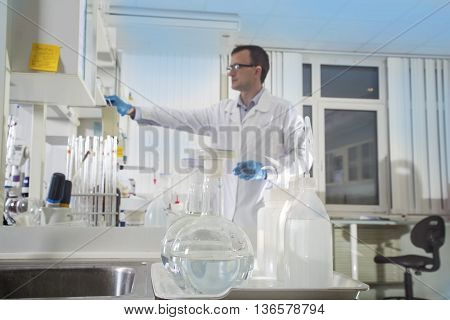 Clean modern white medical or chemical laboratory background. Laboratory concept with caucasian male chemist. Horizontal template for a poster webpage or leaflet.