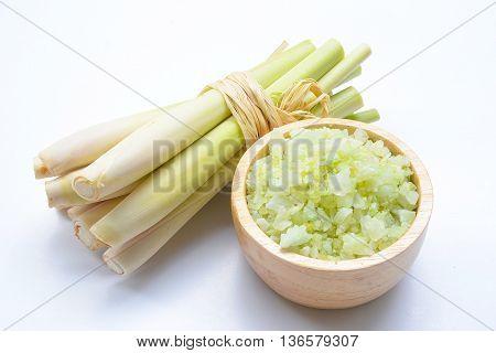 close up green bath salt, lemongrass, and spa