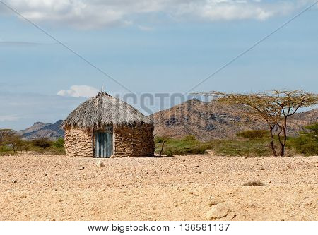 Traditional african huts in desert in Kenya