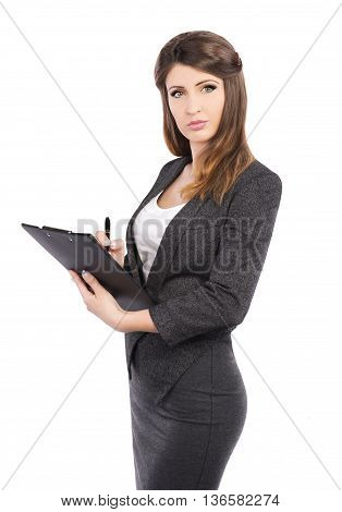 Businesswoman in business suit holding pen and writing