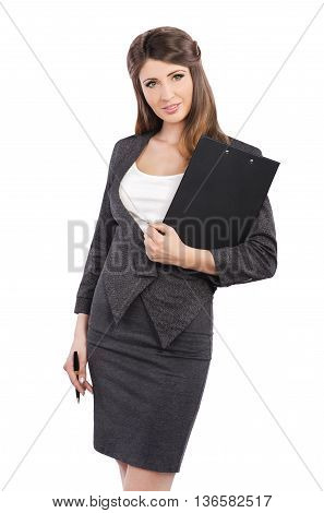 Businesswoman in business suit holding pen and folder