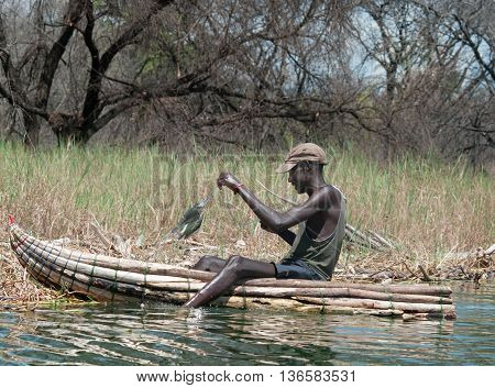 Fisherman Catches A Fish