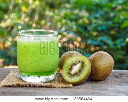 fresh kiwi fruit and kiwi smoothie in garden