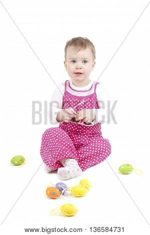 cute baby with eggs on white background