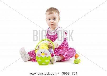 cute baby with Easter eggs on white
