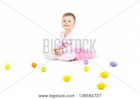 Portrait Of A Cute Baby With Easter Eggs