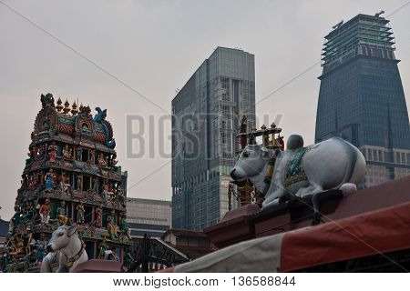 Contrast between old hindu temple and new skyscrapers