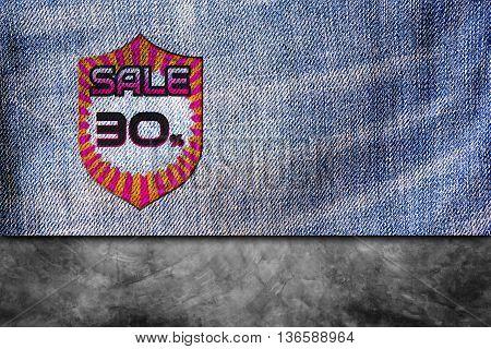 Sale discount labels. 30% off on blue denim jeans background.