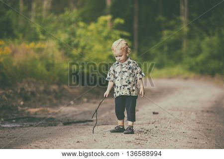 Little Boy Playing Outdoor In Summer Forest