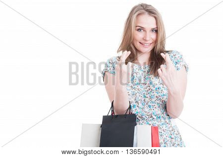 Confident Young Smiling Shopaholic Holding Fingers Crossed