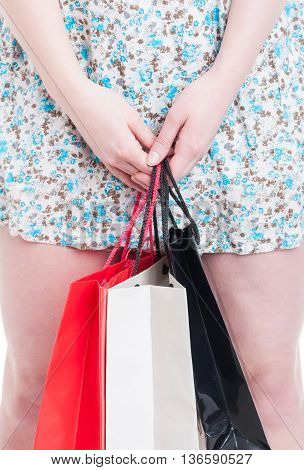 Closeup Of Female Hand Holding Shopping Bags