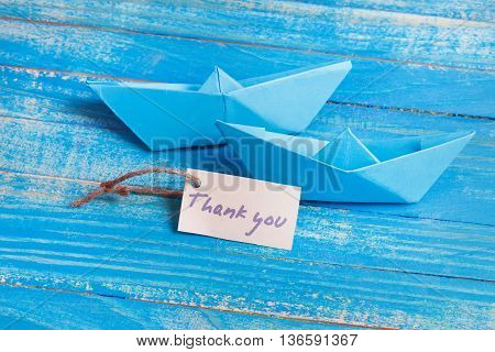 Label with the Words Thank you. Paper Boat with a sign