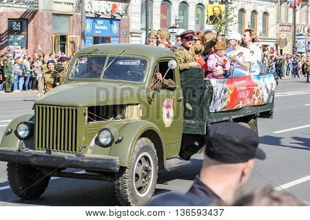 St. Petersburg, Russia - 9 May, Military truck with people in action