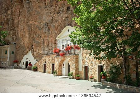 The sanctuary of the Holy Trinity of Vallepietra, in central Italy, is built in a natural cave at the bottom of a tall cliff. The shrine, whose facade resembles a small church inside the mountain, attracts pilgrims and tourists alike.