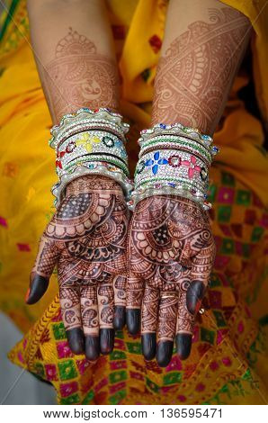 Close view of an Indian bride's hand with henna tattoos