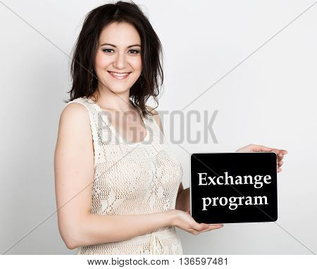 technology, internet and networking - close-up successful woman holding a tablet pc with exchange program sign. internet technology in tourism.