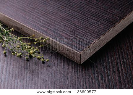 Dark Laminated Chipboard With Decorative Flowers