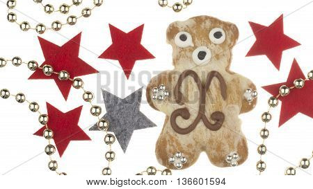 beautiful funny delicious Christmas gingerbread bear decorated with a pattern and a silver sugar balls and Christmas star and beads isolated on white background