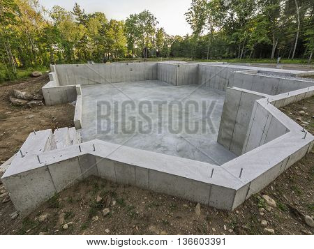 New concrete foundation base for a new house
