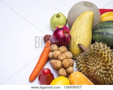 Mix colorful asian fruits of red apple dragon fruit lemon watermelon melon papaya durian guava mango cantaloupe rose apple carrot Salacca and southern langsat on isolated / white background