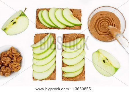 sandwiches with peanut butter and an apple. Apple slices and peanut butter isolated on white background