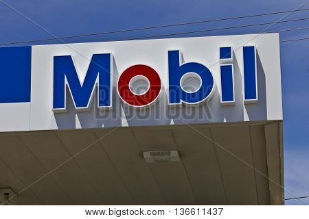 Indianapolis - Circa June 2016: Mobil Gas Station Signage. Mobil Merged with Exxon to Become ExxonMobil Traded as XOM III