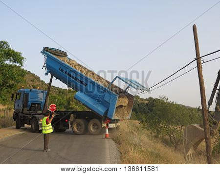 Alora Spain June 29 2016: Lorry delivering rocks for retaining wall