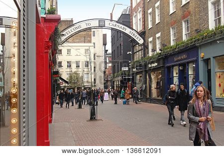 LONDON UK - March 24: Famous pedestrian shopping street with people walking around on Soho in London UK - March 24 2016; Carnaby Street is home to fashion and lifestyle retailers near Regent Street in London.