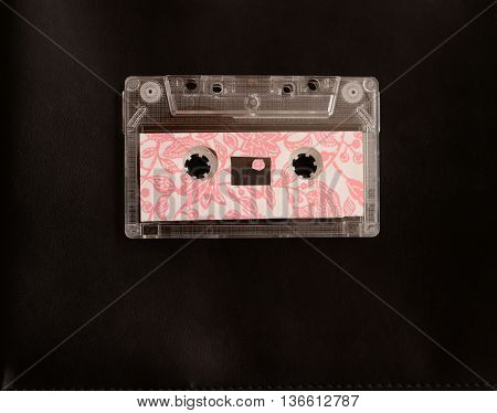 retro pink cassete tape on black background