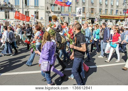 St. Petersburg, Russia - 9 May, People with flowers and flags, 9 May, 2016. Holiday-action