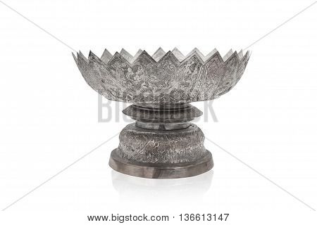 Isolated old Thai style silver pedestal tray. Thai art. Handmade and handy craft.