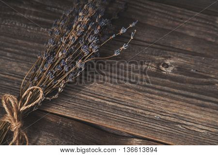 Dried lavender on wooden background, artistic shot