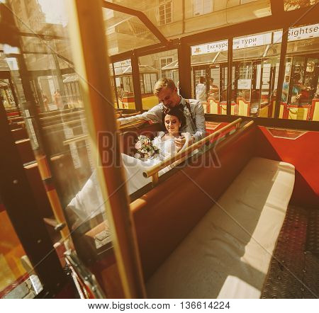 Bride and groom posing in the tour train and have fun
