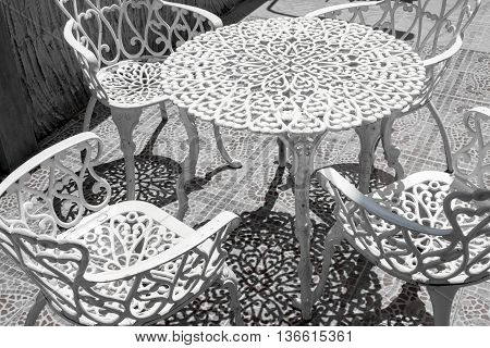 metal outdoor furniture including table and chairs