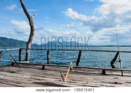 fishing on floating houseboat and beautiful sky over Vachiralongkorn dam Thailand