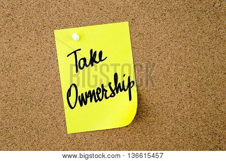 Take Ownership Written On Yellow Paper Note
