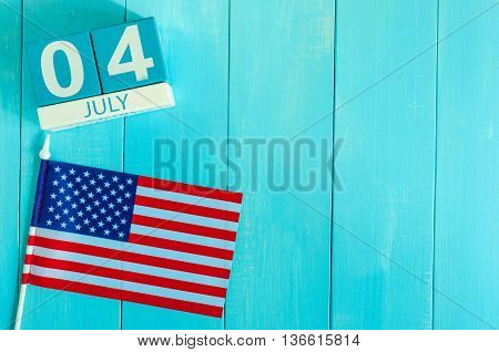 Image of 4th july wooden color calendar with Stars and Stripes flag on blue background. Summer day. Empty space for text. Independence Day Of America.