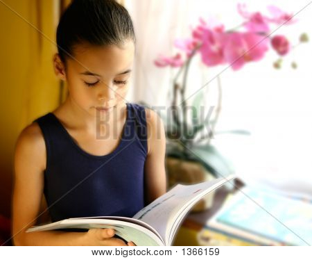 A Young Girl Engross In Her Reading