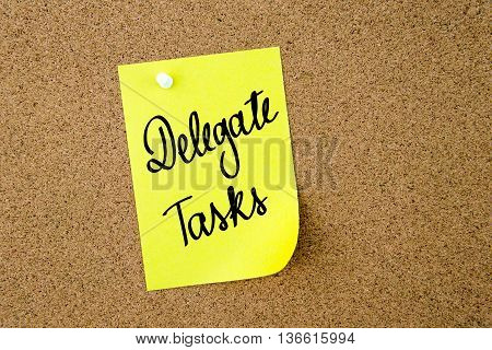 Delegate Tasks Written On Yellow Paper Note