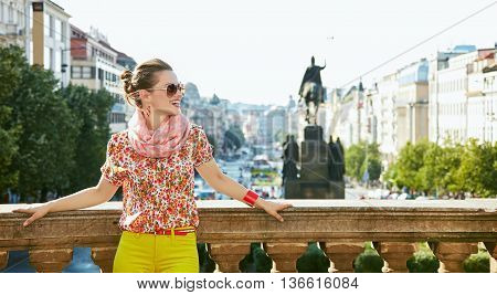 Woman Standing Near National Museum In Prague And Looking Aside